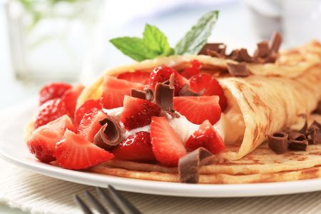 Crepes with curd cheese and fresh strawberries