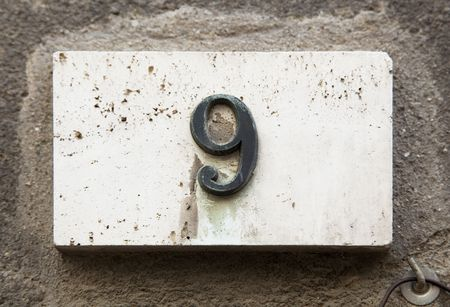 Block number on a weathered wall - detail