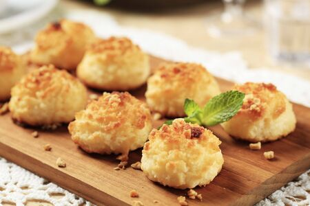 Crisp coconut macaroons on a cutting board