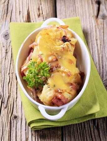 Ham and potato gratin in a casserole dish