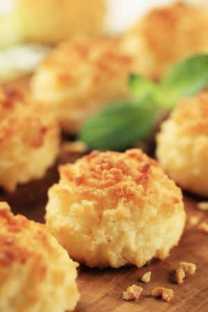 Coconut macaroons sprinkled with chopped nuts - closeup