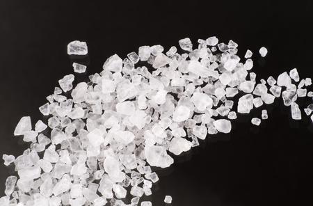 Detail of sea salt crystals on black background