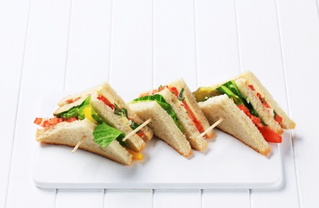 Vegetable sandwich triangles on cutting board