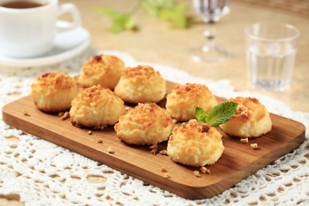 Coconut macaroons on cutting board