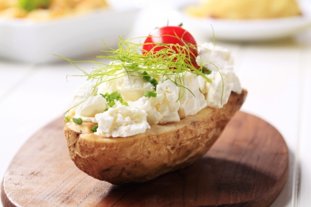 Baked potato topped with cheese