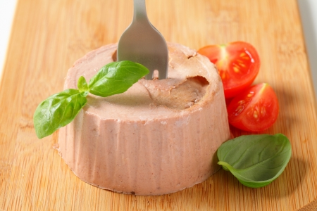 Smooth liver pate on cutting board