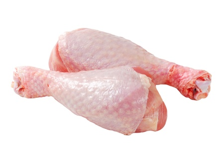 Raw turkey drumsticks isolated on white