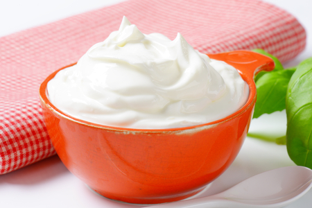 creme fraiche in an orange bowl