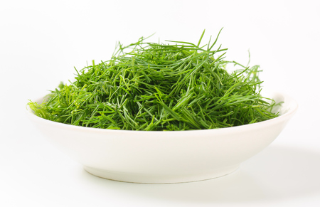 Bowl of fresh chopped dill leaves