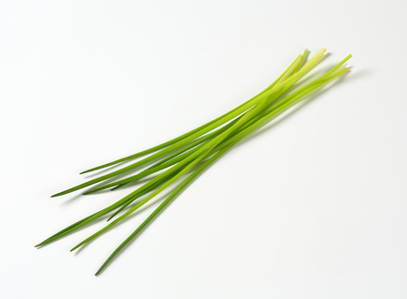 Fresh chives leaves on white background