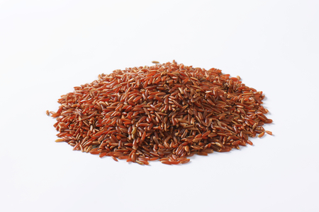 Grains of Camargue red rice (Grown organically in the wetlands of Southern France)