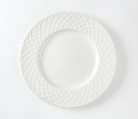 White porcelain plate with lattice pattern on the rim