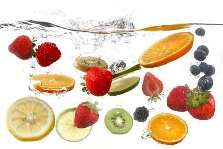 Sliced Fruits Falling Into Splashing Clear Waterの写真素材
