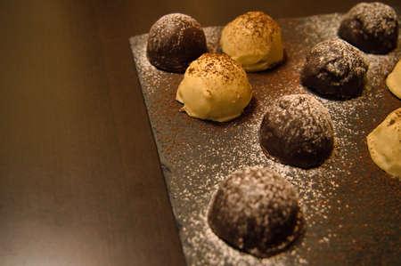 Foto de Dark and white chocolate bonbons filled with raspberry and coconut - Imagen libre de derechos