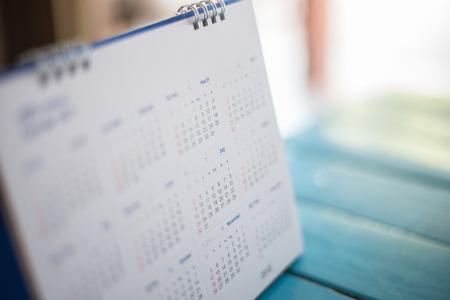 Photo pour Blurred calendar page blue background. - image libre de droit