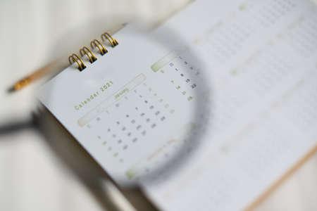 Foto de Blurred calendar in  planning 2021 concept.Blue tone. - Imagen libre de derechos