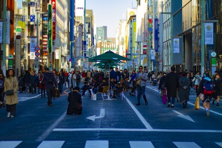 A city street at the downtown in Ginza Tokyo daytime wide shot