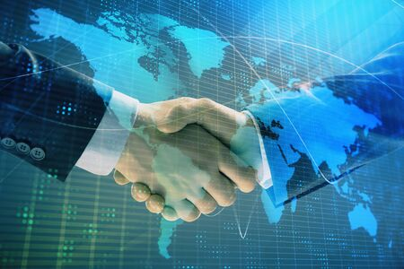 Photo pour Multi exposure of world map on abstract background with two businessmen handshake. Concept of international business - image libre de droit