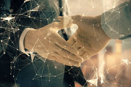 Photo pour Double exposure of abstract technology drawing on cityscape background with two businessmen handshake. Concept of tech role in business - image libre de droit