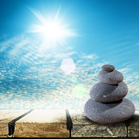 Zen Stones over wooden desk abstract environmental backgrounds