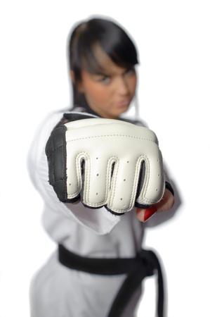 Taekwondo. Woman in a kimono isolated on the white background