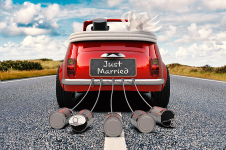 Foto de A newlywed couple is driving a retro car with just married sign and cans rear view 3D rendering - Imagen libre de derechos
