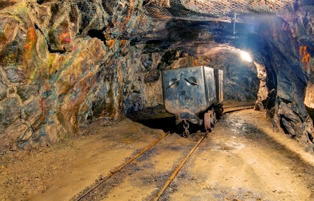 Underground mine with truck and railroad