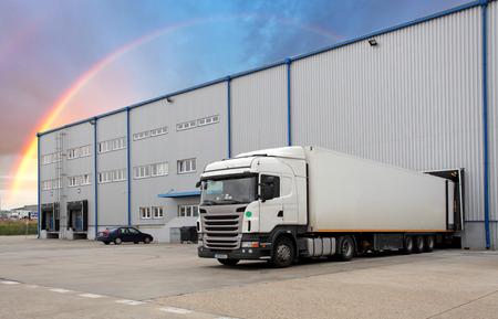 Foto de Cargo Transportation - Truck in the warehouse - Imagen libre de derechos