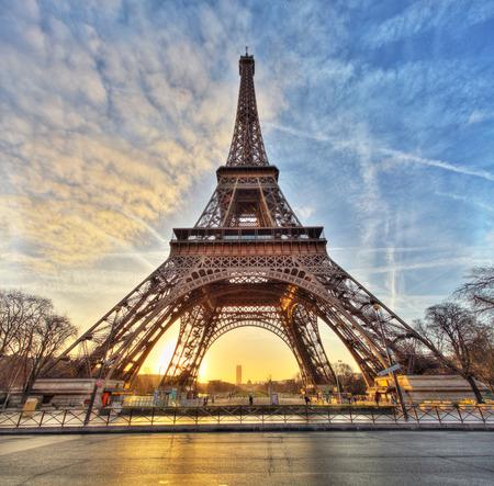 Photo pour Wide shot of Eiffel Tower with dramatic sky Paris France - image libre de droit