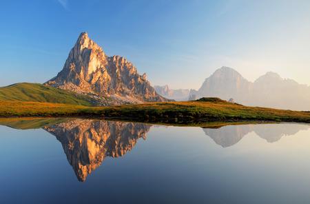 Mountain lake reflection Dolomites Passo Giau