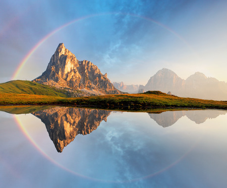 Foto de Rainbow over Mountain lake reflection, Dolomites, Passo Giau - Imagen libre de derechos
