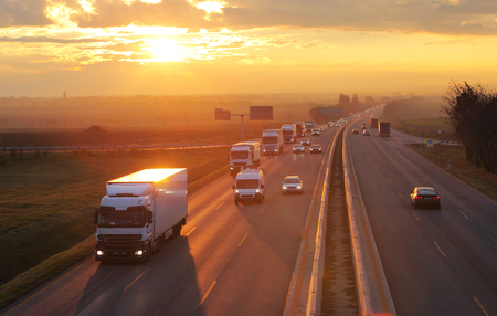 Foto de Highway transportation with cars and Truck - Imagen libre de derechos