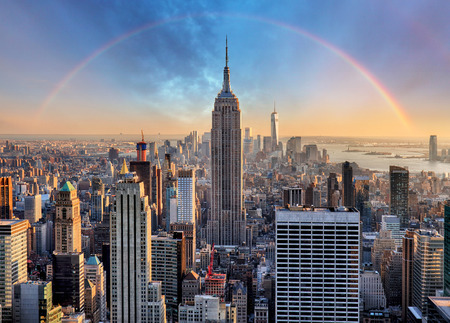 Photo pour New York City skyline with urban skyscrapers and rainbow. - image libre de droit