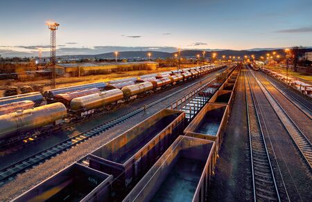 Photo for Cargo train platform at sunset with container - Royalty Free Image