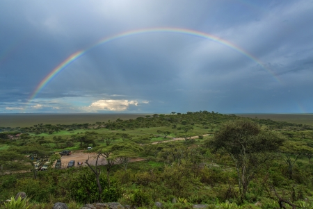 Rainbow over Serengeti plain