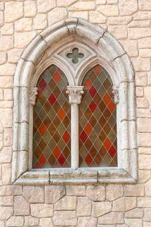 colour stained glass window in stoned church