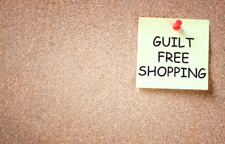 guilt free shopping concept  sticky pinned to board and room for text