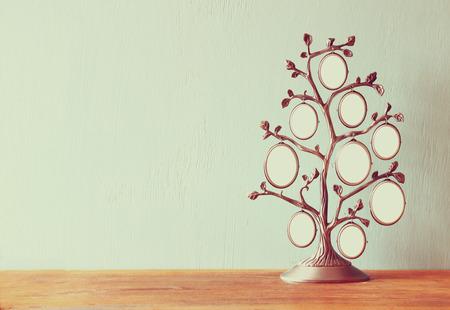 Photo pour Image of vintage antique classical frame of family tree on wooden table - image libre de droit