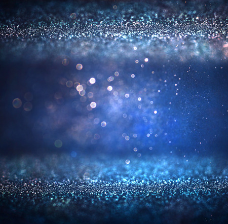 glitter vintage lights background. light silver purple blue gold and black. defocused.