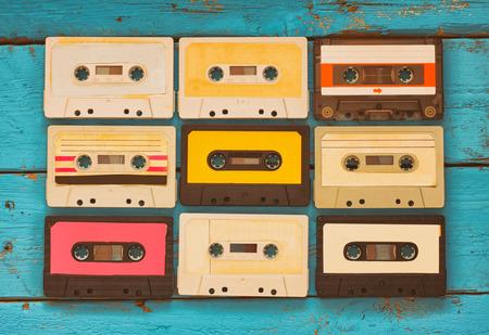 Foto de close up photo of vintage cassette tape over aqua wooden table . top view. retro filtered - Imagen libre de derechos