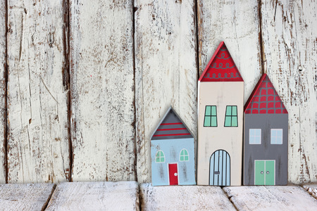 image of vintage wooden colorful houses decoration on wooden table.