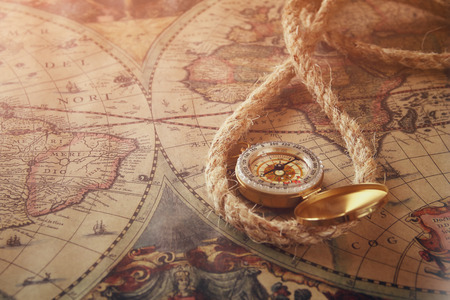 image of old compass  on vintage map