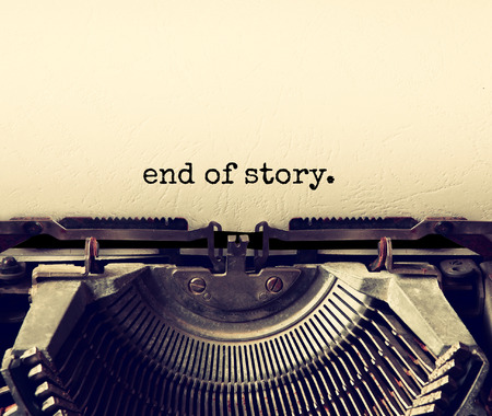 close up image of typewriter with paper sheet and the phrase: end of story. copy space for your text. terto filtered