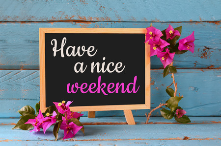 blackboard over blue wooden shelf with the phrase have a nice weekend