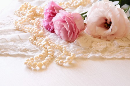 Photo pour Background of white delicate lace fabric and white flowers - image libre de droit