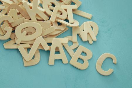 Photo pour Set of a wooden letters of the English alphabet on wooden blue background - image libre de droit