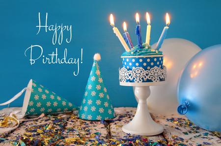 Foto de Birthday concept with cupcake and candles on wooden table. - Imagen libre de derechos
