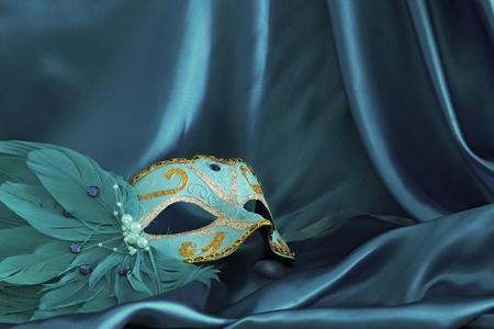 Photo pour Image of elegant venetian mask over blue silk background - image libre de droit