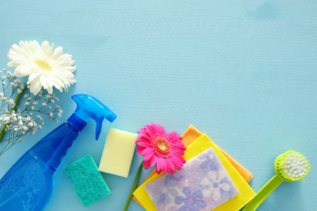 Photo for Spring cleaning concept with supplies on wooden table. Top view - Royalty Free Image