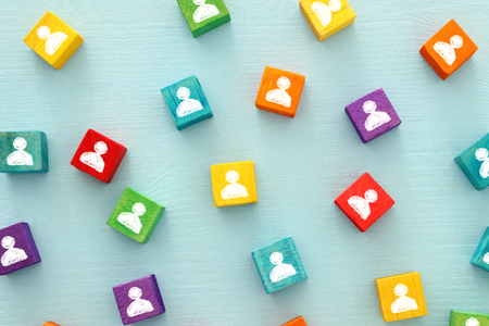 Photo for image of colorful blocks with people icons over wooden table ,human resources and management concept - Royalty Free Image